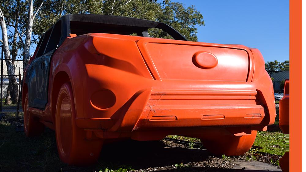 orange plastic car target (prototype) on site