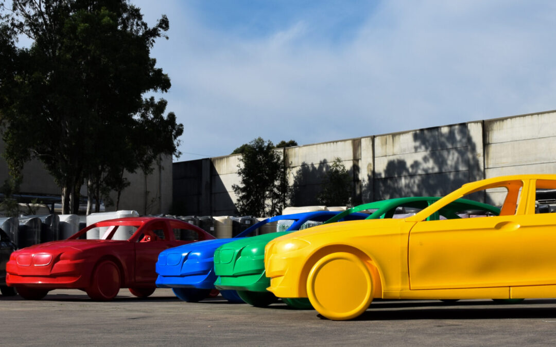 plastic cars in each colour lined up in dramatic curve.