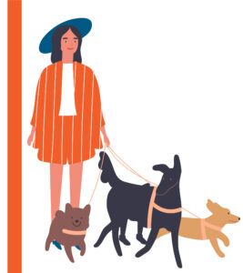 Cool trendy woman with a hat walking her cool dogs.