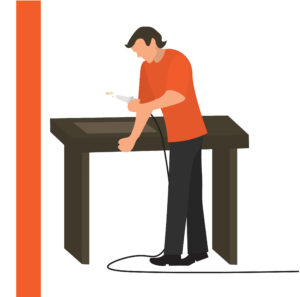 Graphic of man by a table coating a metal sheet